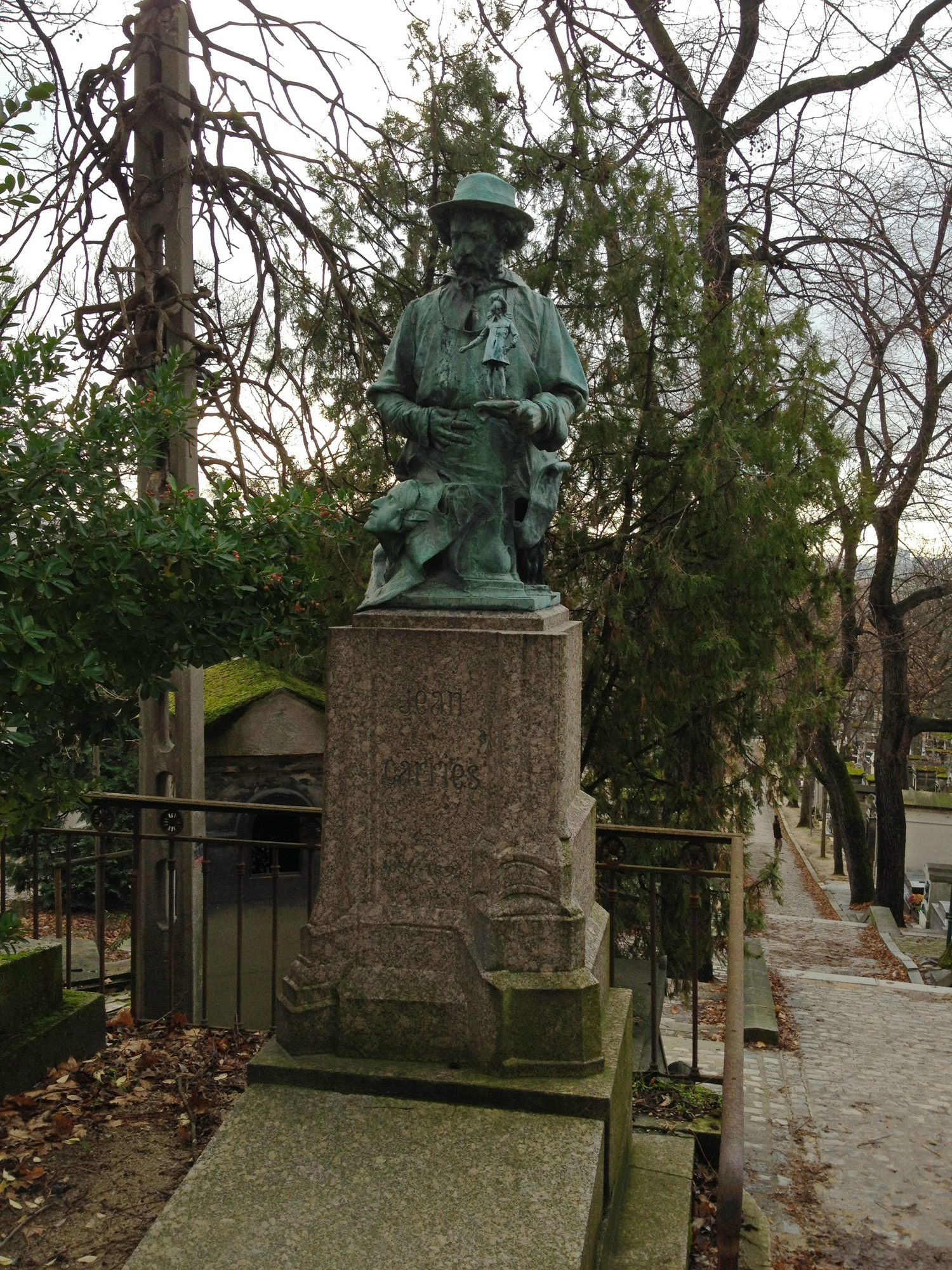 Ventriloquist sculpture at Pere Lachaise Cemetery